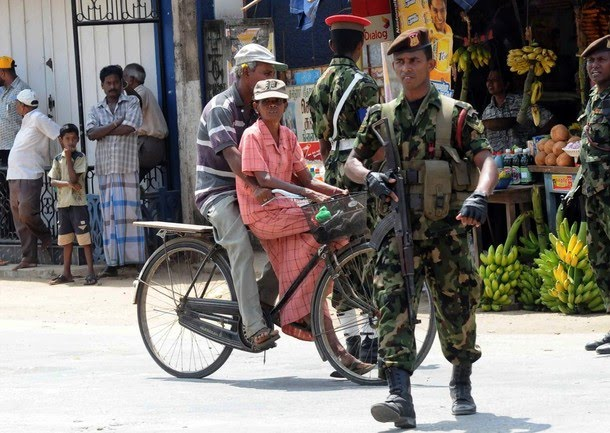soldiers stand alert in a street of Jaffna